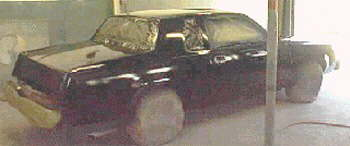 Four coats of black with one coat of clear before car is masked for stripes & lettering 9 Aug '02.