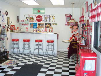 Bettys Showroom. Betty has a 50's diner decorated with Coke and Betty Boop, jukebox and all.