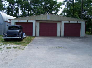 The back of our barn now has three grage doors for our cars and trucks.