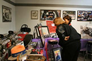 Two potential bidders check out the memorabilia before the auction starts