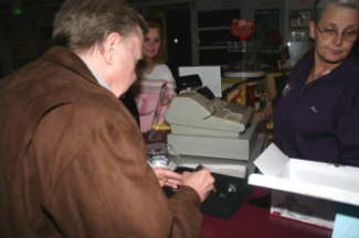 """""""TV"""" Tom Ivo signs a replica of his car for a fan who purchased it from the Museum's gift shop on the Night of Champions."""