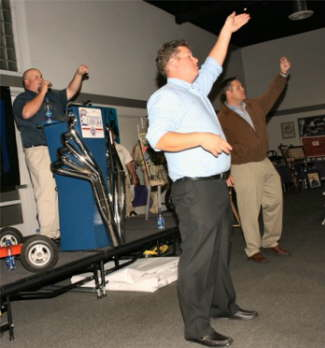 Auctioneers from Ken Porter Auctions exhort the crowd to bid on memorabilia