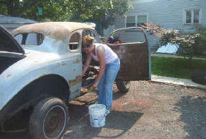 Becky gutting the car
