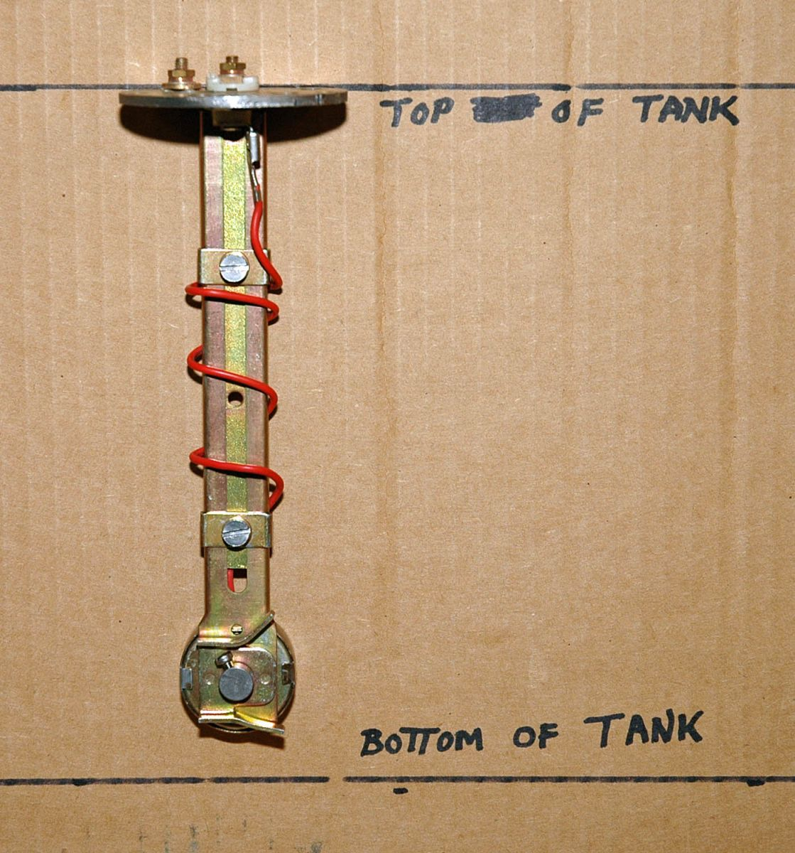 This is a typical fuel tank sending unit with an adjustable float level.  Cardboard marked with top and bottom of tank indicated shows where uncut  sender ...