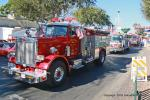 "The traditional ""Parade of Fire Trucks"" began with Debbie Baker in the first of 16 beautiful red trucks from all over the country."