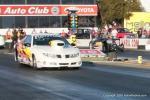 COMPETITION ELIMINATOR – Doug Lambeck (near lane), Pontiac Sunfire, 8.351sec, 156.97mph def. Clint Neff, Bantam roadster, 7.655sec, 156.48mph.