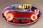 "This great neon sign welcomes you into ""Matt's Garage""."