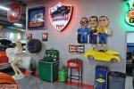 "The ""Garage"" is a jewel with colorful neon signs around the walls, posters and s"