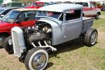 Registered as a 1926, the Model A pickup with tri-power Olds V-8 sold for $6,250.