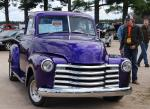 Purple pickup sold for $18,000.
